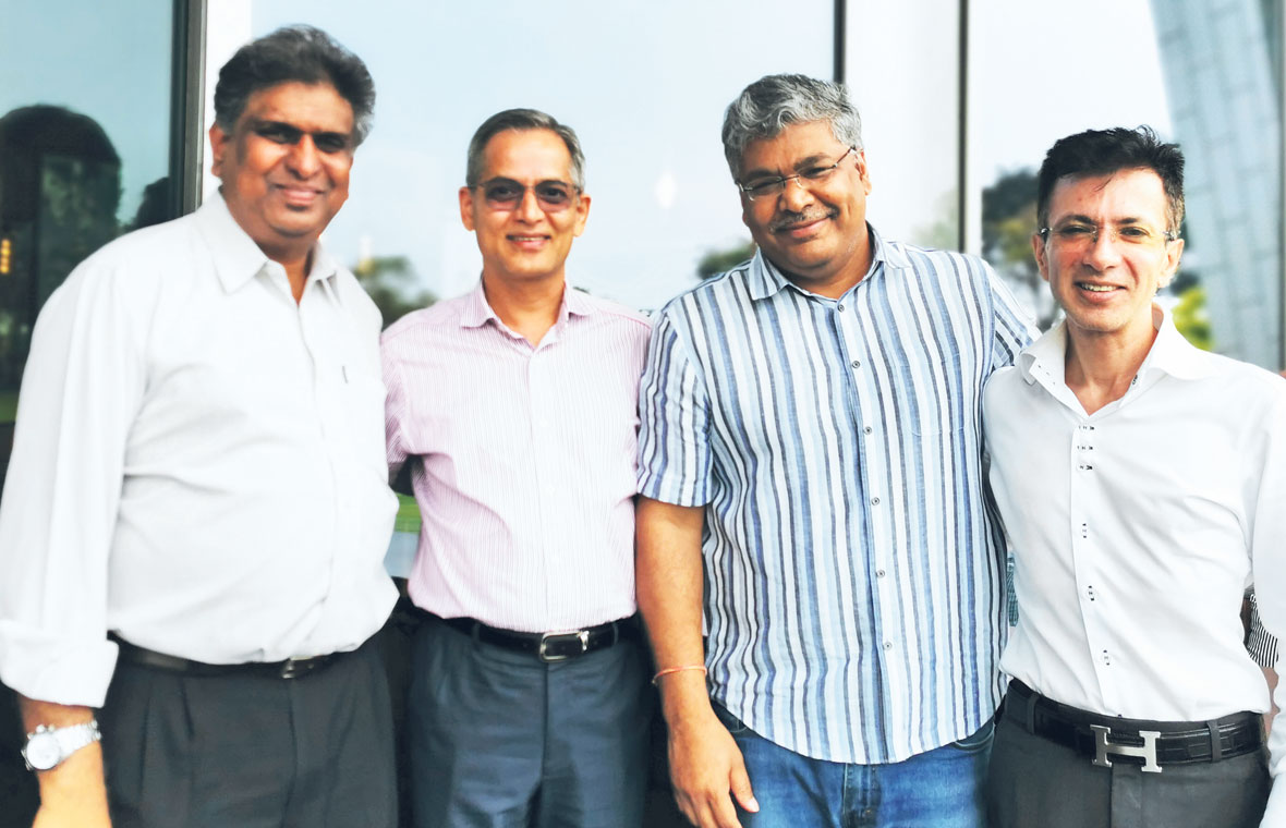 (From left) COO Vinod Martin, CEO Balwant Jain and MDs K. Saravanan and Sumit Malik. PHOTO: OPTIMUM SOLUTIONS